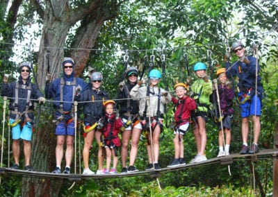 Family on a suspension bridge on a zipline tour in Hawaii
