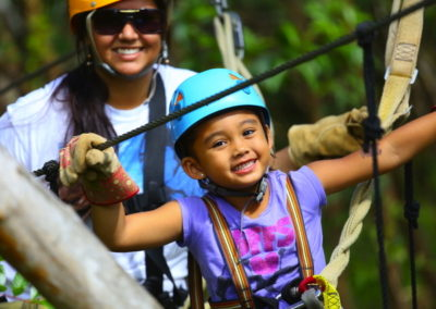A mother and daughter on a family zipline adventure in Maui